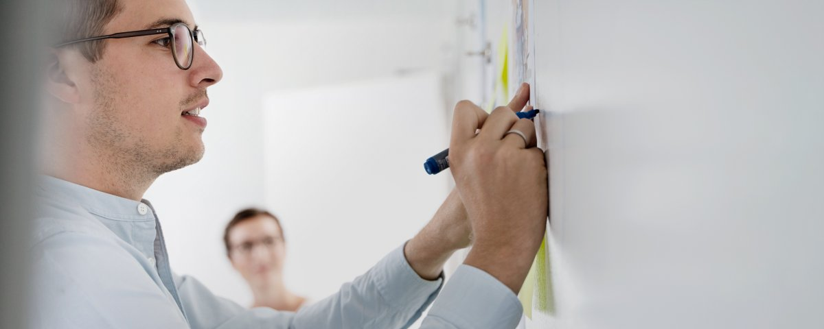 Employees in front of whiteboard