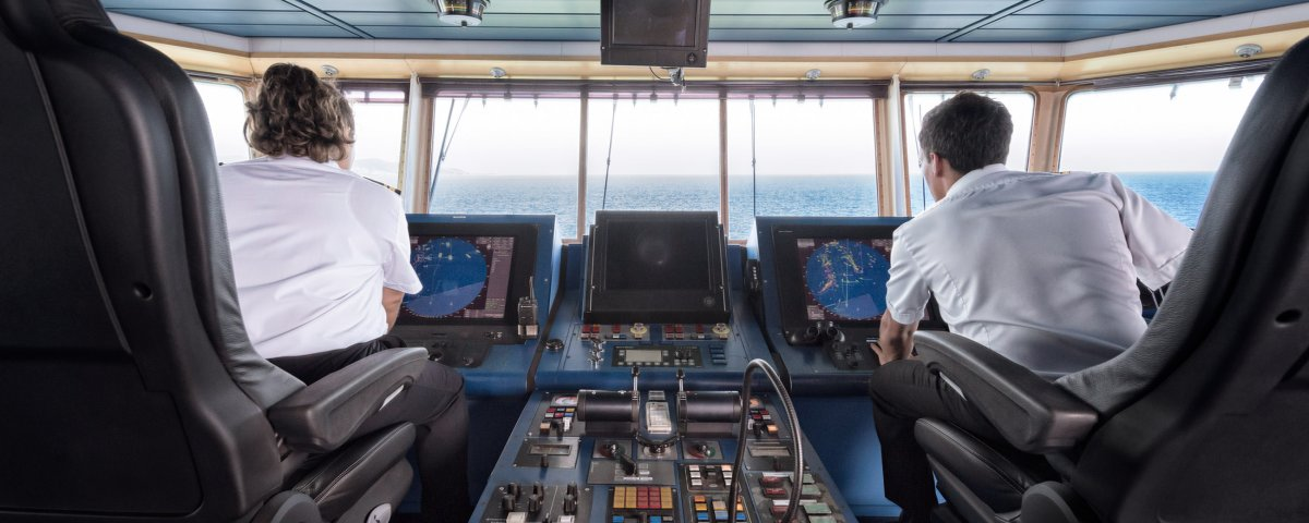 Captains on the bridge of a catamaran