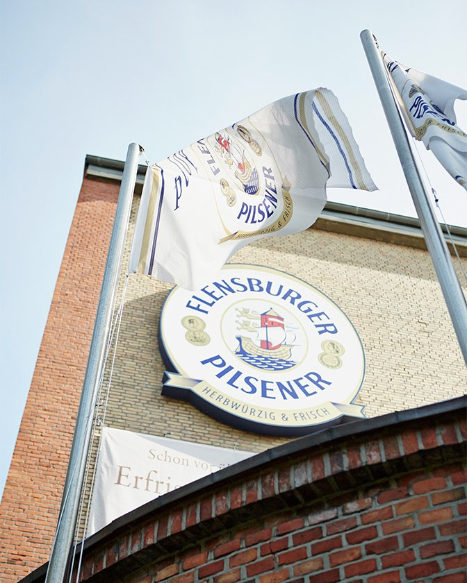 Flensburger flags and logo on the house wall